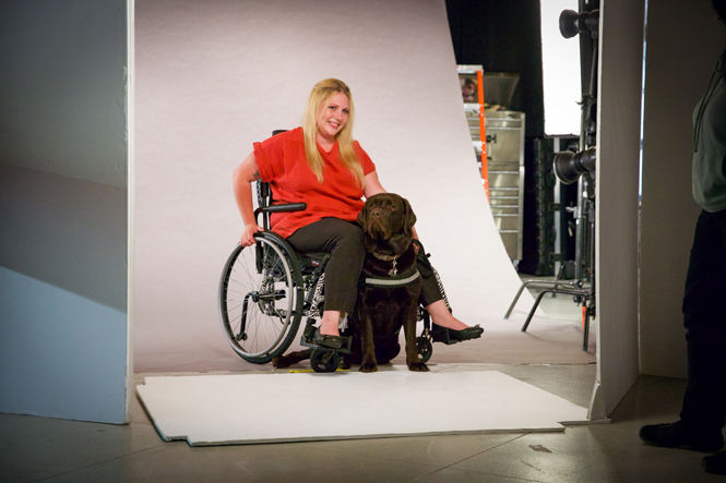 Wheelchair Model with her service dog on set
